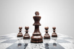 chessboard pieces illustrationg how to beat ploys during negotiation